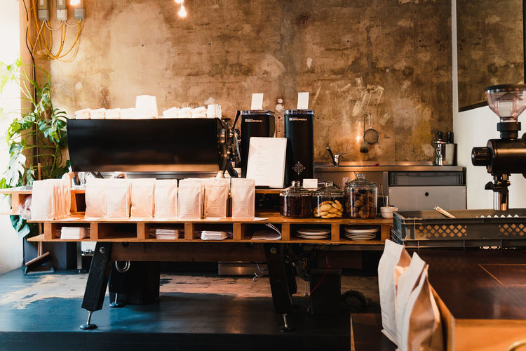 Coffee Stains Absence Book Business Chair Coffee Shop Domestic Room Furniture Indoors  Lighting Equipment Machinery Nature No People Publication Seat Still Life Table Technology Wall Wall - Building Feature Wood - Material
