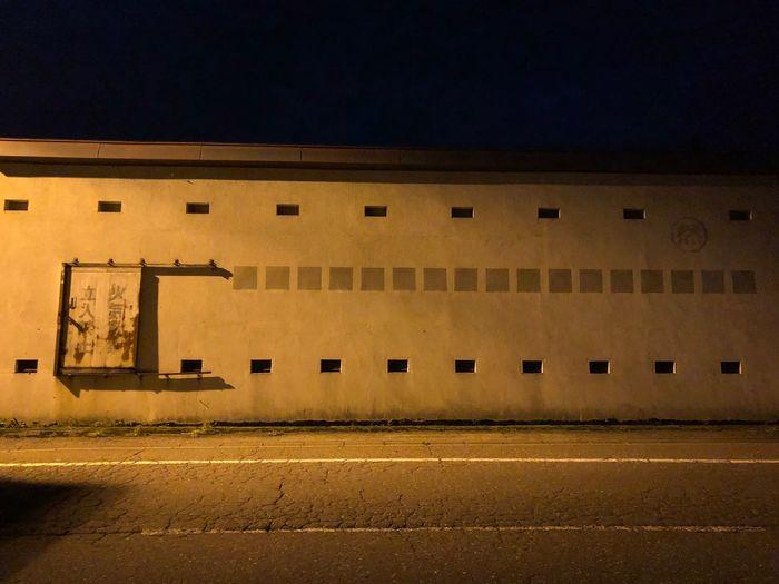 食うのに夢中になった、帰り道の夜。 Architecture Built Structure Building Exterior City Night No People Building Street Window Transportation Road Outdoors Wall - Building Feature Sign Illuminated Road Marking