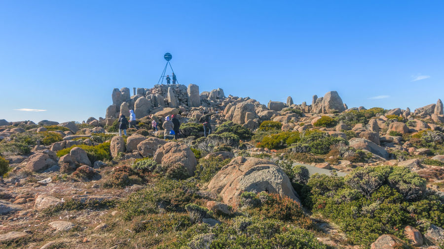 The summit of Kunanyi / Mount Wellington Tasmania Australia Beauty In Nature Blue Building Exterior Built Structure Clear Sky Day Formation Hiking Adventures History Hobart Tasmania Holiday In Tasmania Land Mountain Mountain Peak Mountains And Sky Nature Outdoors Plant Rock Rock - Object Rock Formation Scenic View Scenics - Nature Solid Summit View