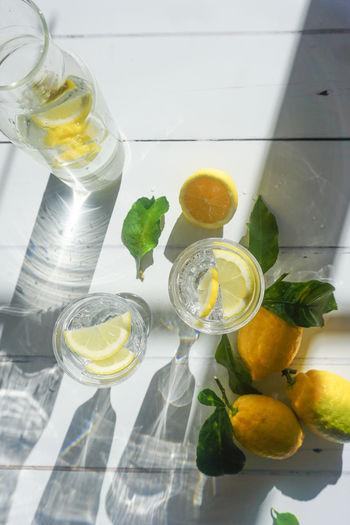 lemonade Lemonade Water Drink Cold Drink Lemon Directly Above White White Background Yellow Lemons Fruit Citrus Fruit Citrus  Copy Space Open Space Drink Fruit Citrus Fruit Yellow Sour Taste