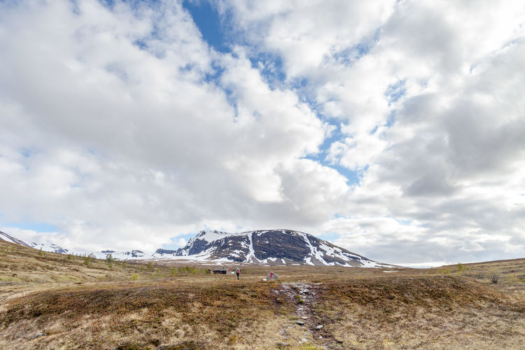 Arrival At Destination Beauty In Nature Cloud Cloud - Sky Cloudy Day Hiking Idyllic Landscape Majestic Mountain Mountain Range Nature No People Non Urban Scene Non-urban Scene Northern Norway Norway Outdoors Remote Scenics Sky Snowcapped Mountain Trollvassbu Weather
