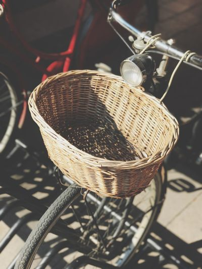 High angle view of wicker basket on bicycle