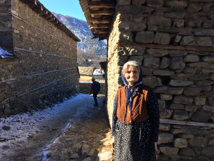 Old Buildings House Tradition Culture Travelling Travel Destinations Standing Outdoors One Person Day Lifestyles Real People Built Structure Architecture One Woman Only Nature Winter Go Higher Inner Power This Is Aging