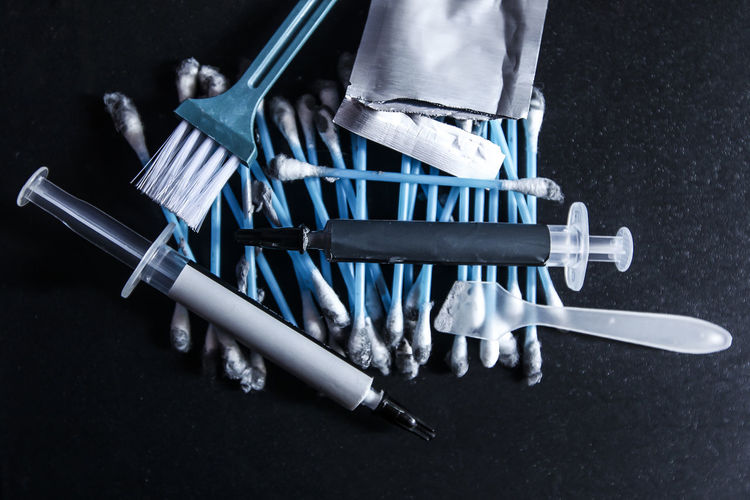 Close up. Cotton buds, Scrapers, brushes, grease Cleanser packages and inject specific gravity have been used on the table Close-up Day Healthcare And Medicine Human Body Part Human Hand Indoors  Low Section One Man Only One Person People