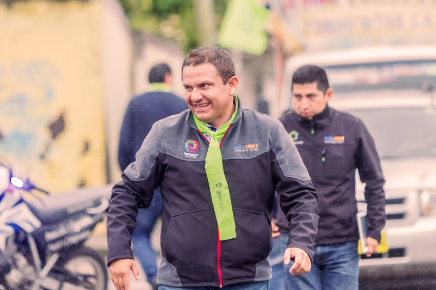 Banos De Agua Santa, Ecuador - 23 June, 2016: Mayor Of Banos De Agua Santa, Marlon Guevara, Walking At The Streets Of Town, Ecuador, South America Adult Adults Only BañosEcuador Crowd Day Lifestyles Manifestation Mayor Men Occupation Only Men Outdoors Peace People Politics President South America Standing Supporters Teamwork Technology Togetherness Two People Young Adult Young Men