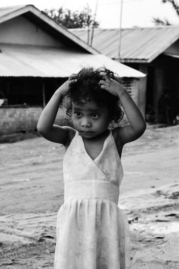 A little girl wearing her dress. 💕 Aetas Aeta Eye Em Philippines Philippines Childhood Girls Elementary Age One Person Real People Front View Cute Looking At Camera Focus On Foreground Portrait Outdoors Happiness Leisure Activity Standing Day Lifestyles Smiling Architecture Building Exterior People The Week On EyeEm