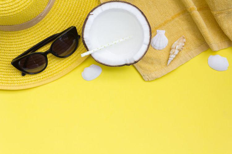 High angle view of seashell on sunglasses