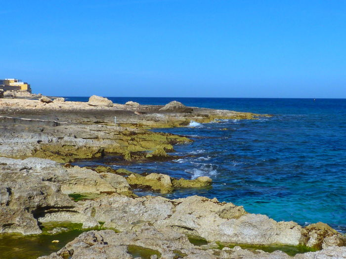 Malta Paceville St. Julian's San Giljan Mediterranean  Mediterranean Sea Rock Beach Beach Rock Rocks Rocks And Water Sea Water Horizon Over Water Horizon Sky Scenics - Nature Blue Beauty In Nature Nature No People Day Outdoors