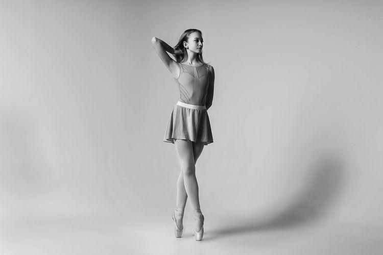 Ballet dancing against gray background