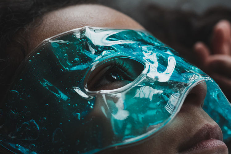 Close-up portrait of girl wearing eye therapy mask