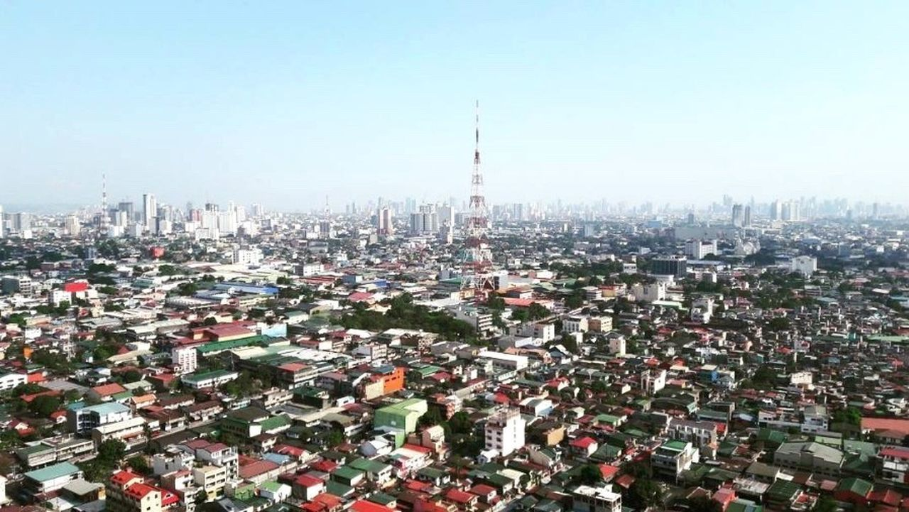 architecture, cityscape, built structure, building exterior, city, tower, skyscraper, high angle view, no people, day, outdoors, travel destinations, sky, clear sky, urban skyline
