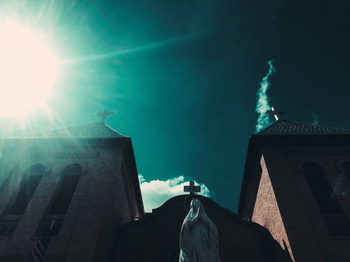 Take in old Mesilla New Mexico. The sun was there...not edited. Blue Cross Church Architecture Built Structure Building Exterior Sky Low Angle View Nature Building Sunlight No People Sunbeam Cloud - Sky Travel Destinations Outdoors Lens Flare City Day Tourism Tower