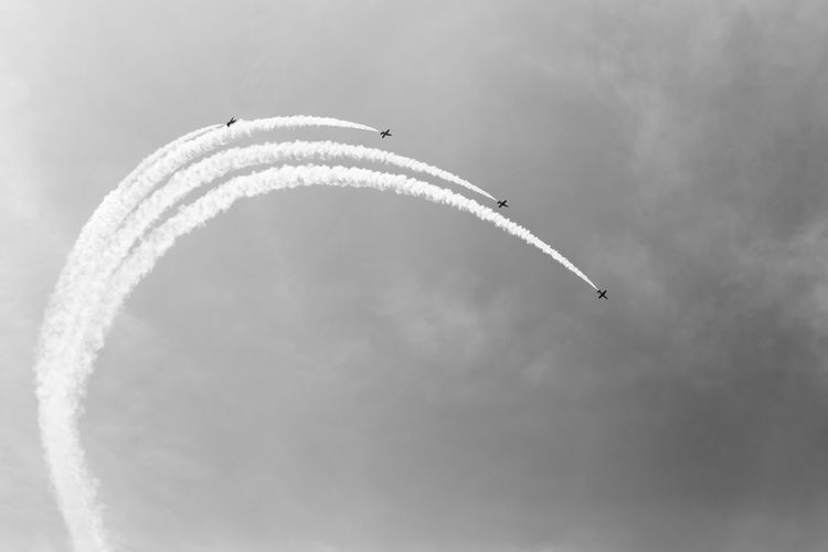 Flying Airplane Air Vehicle Cloud - Sky Vapor Trail Airshow Sky Motion Teamwork Smoke - Physical Structure on the move Mode Of Transportation Speed Low Angle View Cooperation Plane Transportation Fighter Plane Mid-air No People Order Outdoors Aerobatics Trail Blackandwhite Black And White Black & White Skyporn