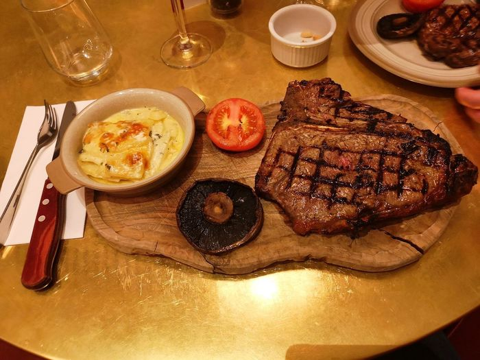 steak dinner Porterhouse Porterhouse Steak 22oz Steak Dauphinois Meat Plate Table Grilled Close-up Food And Drink Steak Beef Red Meat Char-grilled