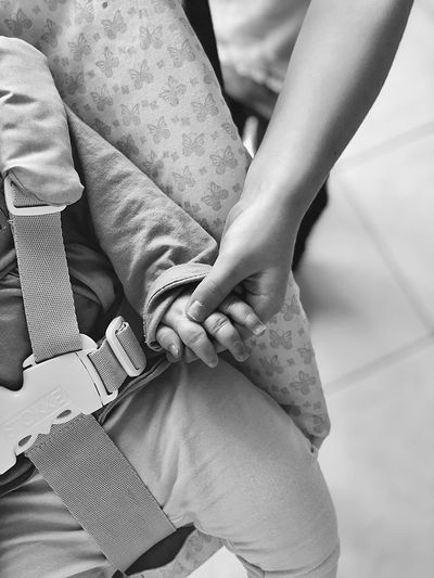 Cropped Hand Of Mother Holding Hand Of Baby