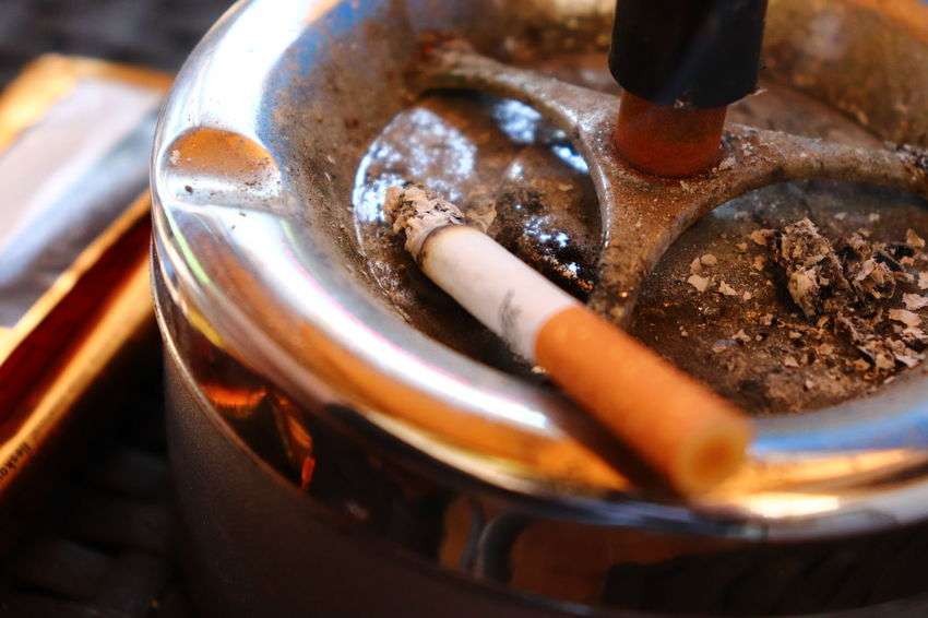 Image result for cigarette in ashtray
