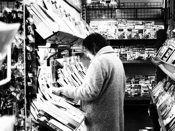 Rear view of man standing in store