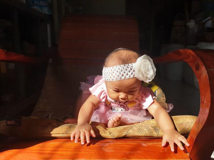 Full length of cute baby girl at home