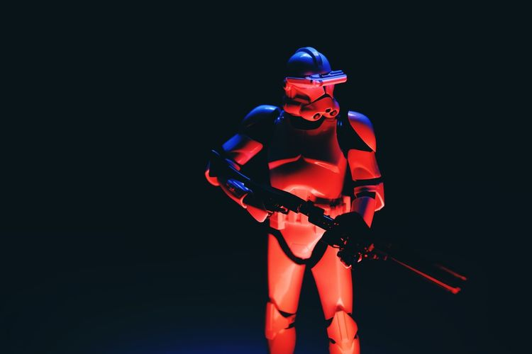 Studio Shot One Person Indoors  Front View Headwear Standing Three Quarter Length Black Background Helmet Determination Adult Copy Space Illuminated Dark Clothing Robot Holding Night Futuristic Star Wars Clone Trooper Clonetrooper Light Painting Light And Shadow Star - Space Hobby Toys Scale Model Scale Model Photography