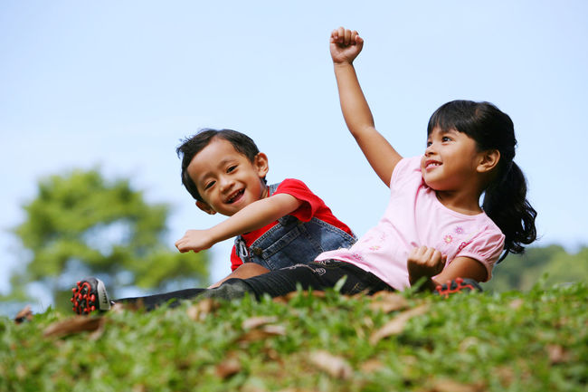 kid playing in a park Brother Grass Happiness Sister Arms Raised Casual Clothing Childhood Day Elementary Age Excited Full Length Girl Happiness Laugh Leisure Activity Outdoors Outdoors Photograpghy  Park Real People Rural Scent Sibling Side By Side Sky Smile Two People