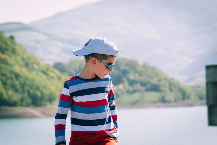 Boys Cap Casual Clothing Child Childhood Day Focus On Foreground Innocence Leisure Activity Lifestyles Looking Males  Men Nature One Person Outdoors Real People Standing Striped