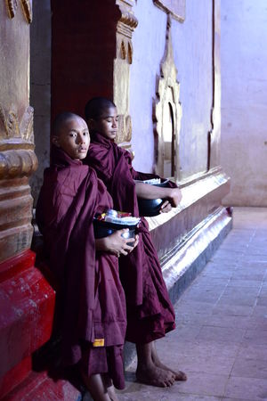 Young monks in Ananda Pahto temple. Bagan. Myanmar Ananda Ananda Temple Burma Temple Bagan Bagan Temple Bagan, Myanmar Buddhism Buddhist Culture Buddhist Monks Buddhist Temple Burma Burma People Completely Bald Myanmar People Real People Religion Shaved Head Southeastasia Temple Togetherness Traditional Clothing Two People Young Adult