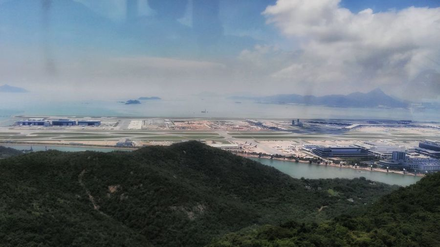 Showing Imperfection Long Shot HK Airport Gondola Ride NgongPing Holiday Sea Hills N Tarmac