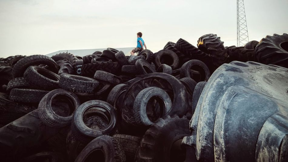 Photo essay - A day in the life. Western to Alexandria, Nebraska September 2016 A Day In The Life Abundance Camera Work Climbing Composition Eye For Photography EyeEm Best Edits EyeEm Best Shots EyeEm Gallery EyeEm Masterclass FUJIFILM X-T1 Heap Kids Being Kids Large Group Of Objects Nebraska Outdoors Photo Essay Recycling Rural America Rural Life Stack Strobist Tire Tires Wide Angle