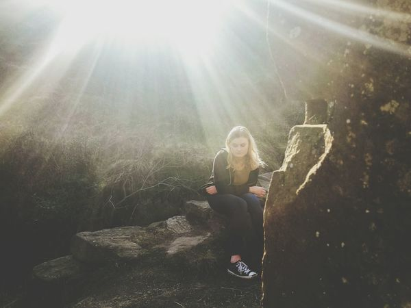 Sitting One Person Full Length Lens Flare People Sunlight One Girl Only Sunbeam Beauty Fragility Day Outdoors Young Adult Adult Portrait Sunbeams Beauty In Nature Dazzle Sitting Landscape Betterlandscapes Countryside Rugged Landscapes Leisure Activity Long Goodbye Lost In The Landscape