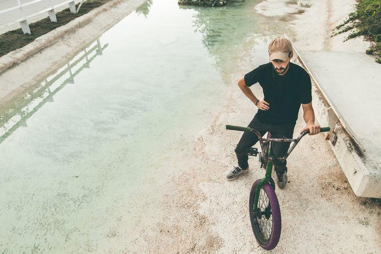 Man riding bicycle on lake