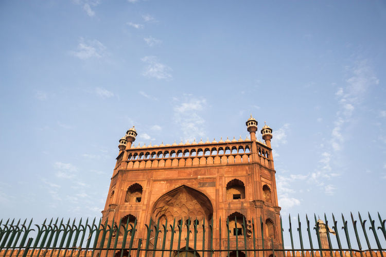 view of Jama Masjid from fence in delhi, India Arch Architectural Feature Architecture Blue Built Structure Day Delhi Exterior Fence Historic India Indiapictures Indiatravel JamaMasjid Low Angle View No People Tourism Travel Destinations