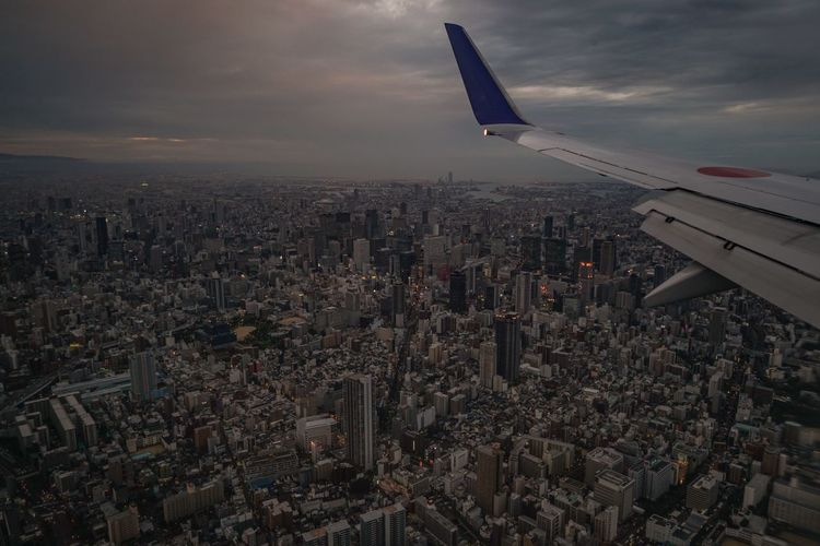 Aerial Shot Landing OSAKA Osaka,Japan Aerial Aerial View Air Vehicle Airplane Architecture Building Building Exterior Built Structure City Cityscape Cloud - Sky Crowd Crowded Flying Outdoors Sky Transportation Window Seat