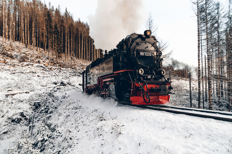 Train on railroad tracks during winter