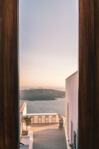Scenic view of sea against clear sky seen through window
