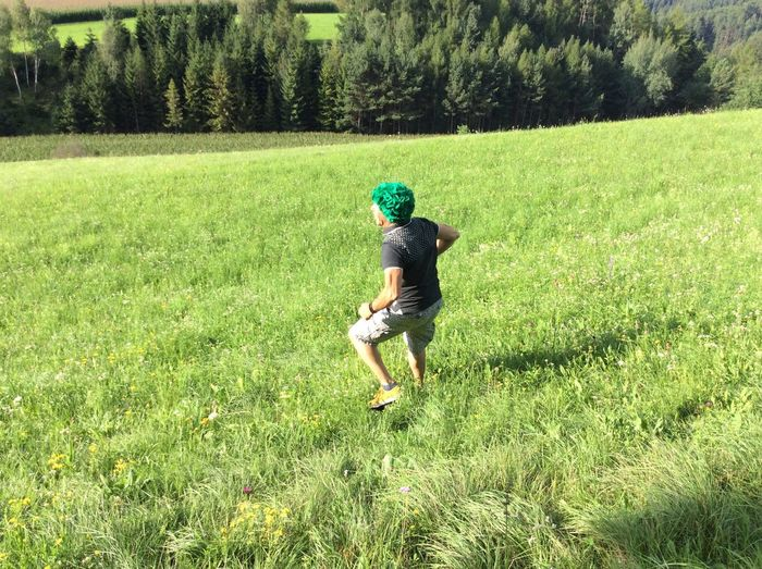 Adult Adventure Day Field Full Length Grass Green Color Growth Lifestyles Nature One Person Outdoors People Real People Running Tree Walking Young Adult