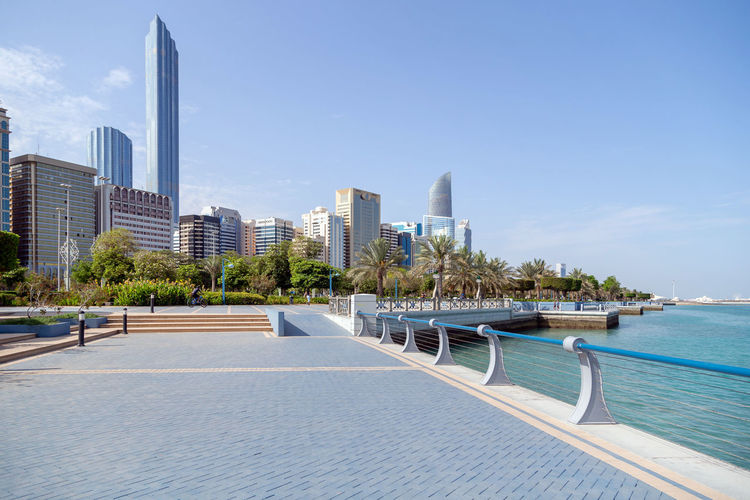 Abu dhabi corniche in the morning. modern skyscapers at the background.
