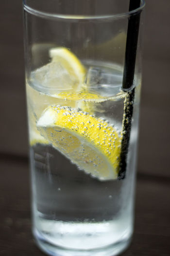 Close-up of lemon in drink on table