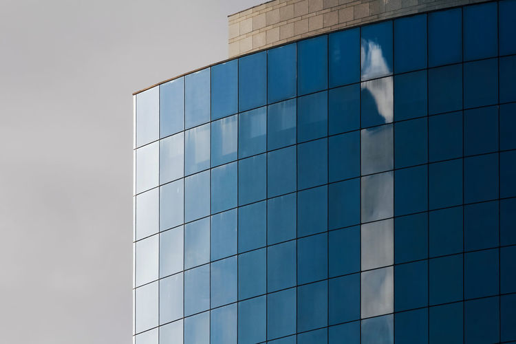 Built Structure Architecture Building Exterior Building Reflection Glass - Material Sky Office Building Exterior Low Angle View Modern Office City Day No People Nature Cloud - Sky Outdoors Shape Blue Window Skyscraper