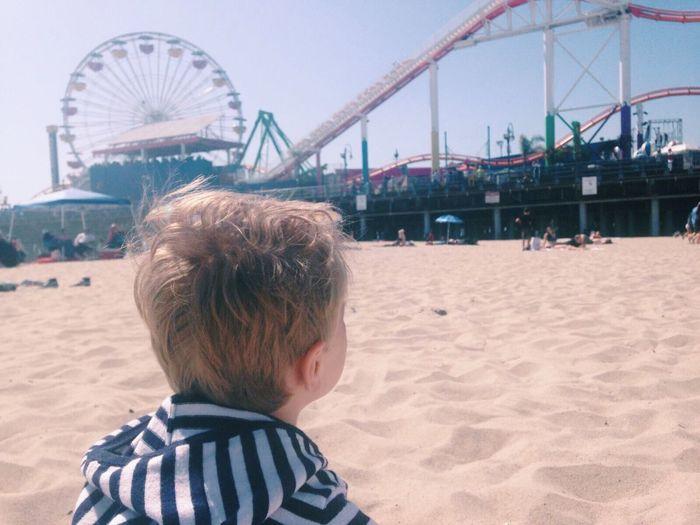 Close-Up Rear View Of Boy At Santa Monica Pier