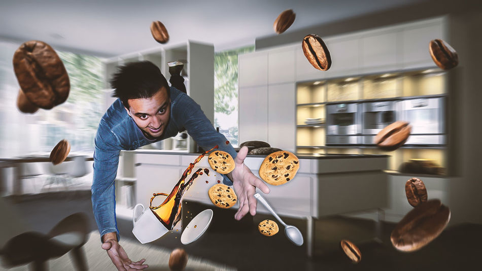 A young man falls with his coffee Coffee Cookies EyeEmNewHere Food And Drink Spoon Dropping Kitchen Young Men