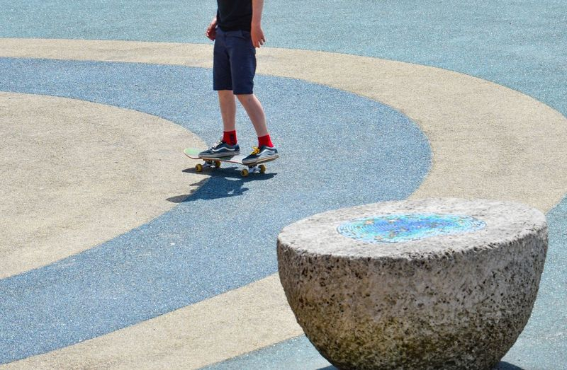 Circles Sunshine Asphalt Blue Circles Skater Skating Skateboard Low Section Real People One Person Lifestyles Human Leg Leisure Activity Sunlight Day City Body Part Child Sport Transportation Shadow Outdoors The Street Photographer - 2018 EyeEm Awards 10 Summer Sports