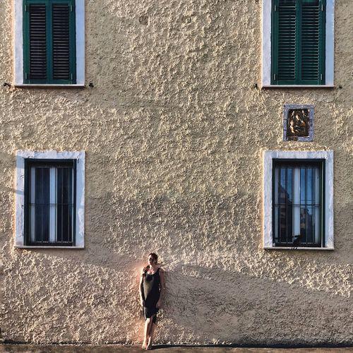 Full length of man on window