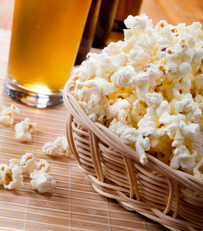 Crunchy popcorn in basket and beer in glass tankard, some popcorn spilled out of wicker basket on mat. Traditional food prepared and ready to eat, standing on mat on table, zoom, vertical orientation, objects in studio shot. Basket Beer Beer - Alcohol Crisp Crunchy Drink Drinking Glass Fast Food Food Food And Drink Heap Maize No People Pop Corn Popcorn Popped Prepared Snack Snacks Unhealthy Eating Wicker Wickerwork