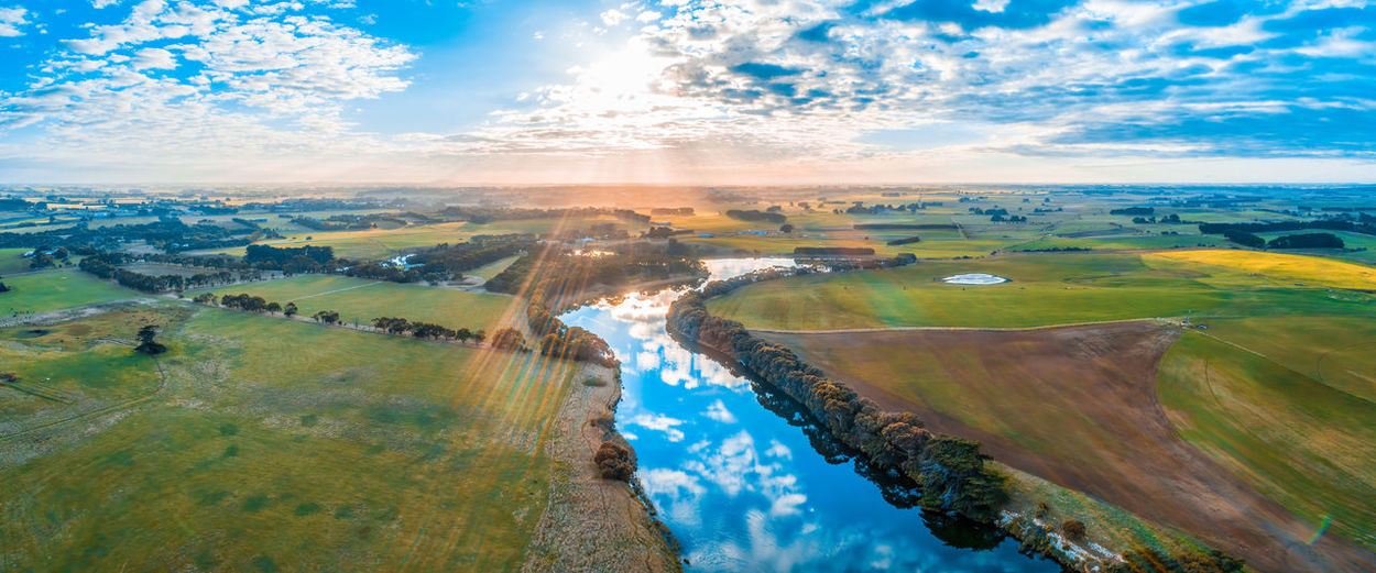 Allansford Cloudscape High Up Hopkins River Horizon Landscape Panoramic Sky Sunrise Travel Locations Aerial Agriculture Australia Background Beautiful Countryside Drone  Farmland Fields Flare Grass Grassland Lens Flare Lookout Meadows Outdoor Panorama Pastures Reflections River Scenic Sun Flare Sunset Travel Travel Destinations Victoria View Warrnambool Water