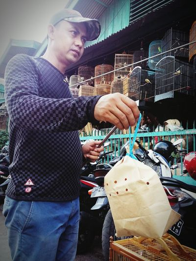 No Big Mac, But Only a Small Bird inside :) | Pet Market Here Belongs To Me My City, My Life Observing People Jakarta, Indonesia The Photojournalist - 2016 EyeEm Awards The Street Photographer - 2016 EyeEm Awards