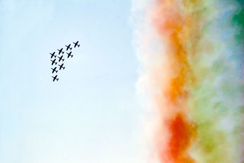 Low Angle View Of Airshow Flying In Sky