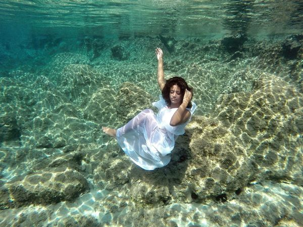 """Even the loveliest dream bears like a blemish its difference from reality, the awareness that what it grants is mere illusion. ""  Theodor Wiesengrund Adorno _ Underwater Photography Glamour Model Eye4photography  EyeEm Best Shots Sea Bodylanguage Girl EyeEm Nature Lover Gopro"