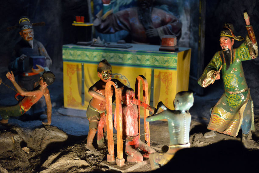 Scenes from Haw Par Villa in Singapore Burning Ceremony Chinese Cultures Day Figurine  Flame Folklore Hell Indoors  Legends Mythology No People Place Of Worship Religion Sculpture Singapore Spirituality Statue Statue Strange Theme Park