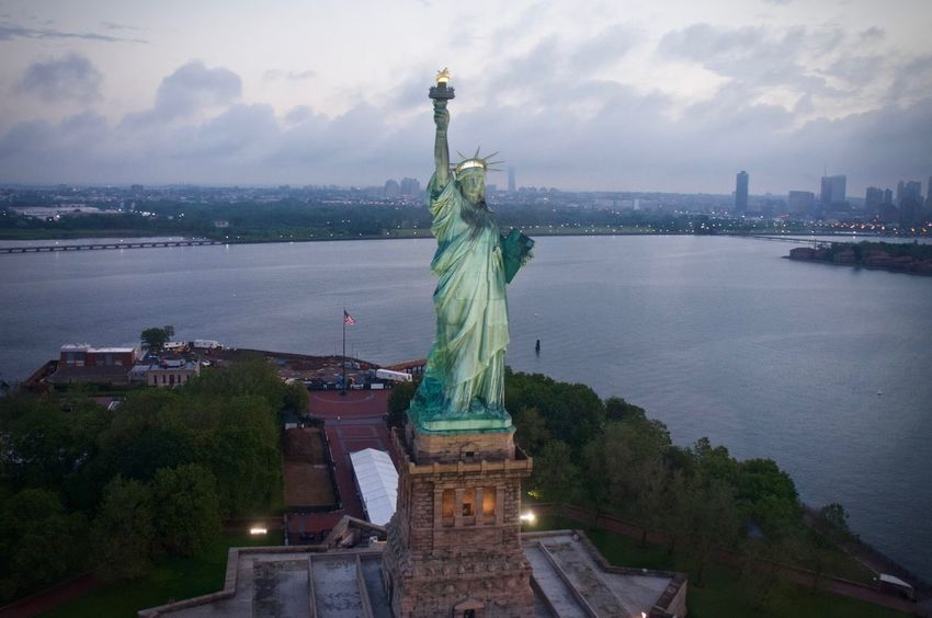Closeup Shot of Statue of Liberty taken from a Helicopter on an Early Morning. Aerial Aerial Shot Aerial View America Architecture Building Exterior Built Structure City Cityscape Cloud - Sky Freedom Gotham Helicopter View  Immigration Liberty Liberty Island New York New York City New York Harbor Sculpture Sky Statue Statue Of Liberty Travel Water