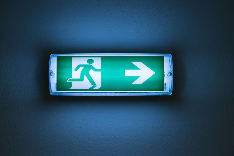 Arrow Symbol Close-up Communication Control Direction Emergency Exit Emergency Sign Escape Exit Sign Guidance Illuminated Indoors  No People Symbol Urgency